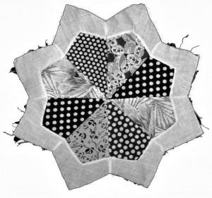 Fragment of a pieced star quilt made by Julian Samora's mother, M. Carmen Samora.